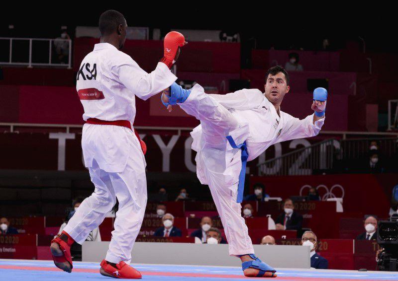 Sajad Ganjzadeh và Tareg Hamedi trong trận chung kết kumite hạng cân trên 75kg.