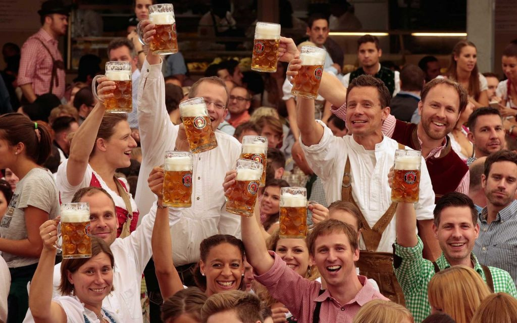 MUNICH, GERMANY - SEPTEMBER 19:  Revelers raise their beer glasses at the Paulaner beer tent on the opening day of the 2015 Oktoberfest on September 19, 2015 in Munich, Germany. The 182nd Oktoberfest will be open to the public from September 19 through October 4and will draw millions of visitors from across the globe in the world's largest beer fest..  (Photo by Johannes Simon/Getty Images)