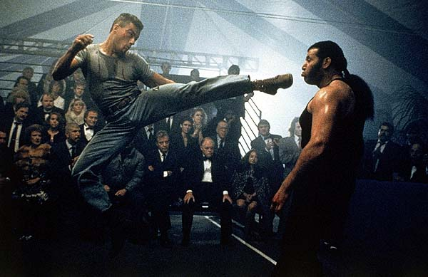 """In this photo provided by Universal City Studios, international martial arts expert Jean-Claude Van Damme, left, stars as a soldier out to avenge the death of his brother in this scene from the film, """"Lionheart"""", 1990. (AP Photo/Universal City Studios/Gary Farr) No Sales"""