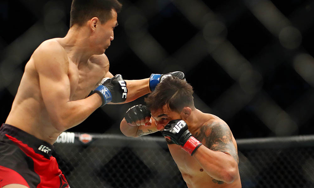 Feb 4, 2017; Houston, TX, USA; Dennis Bermudez (red gloves) fights Chan Sung Jung (blue gloves) during UFC Fight Night at Toyota Center. Mandatory Credit: Mark J. Rebilas-USA TODAY Sports