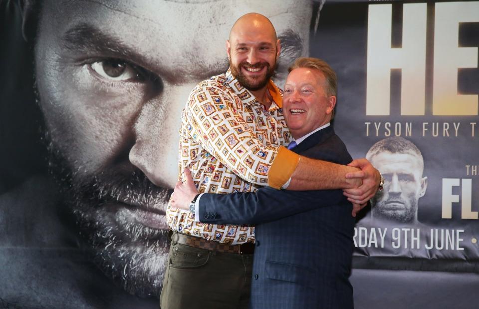 Tyson Fury và nhà quảng báFrank Warren.